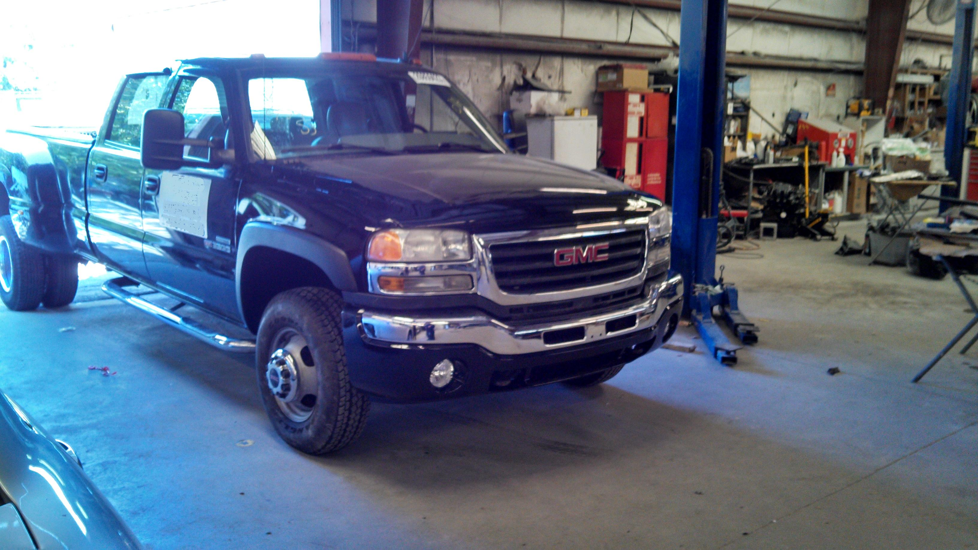 GMC hard front hit auto body collision repair work after