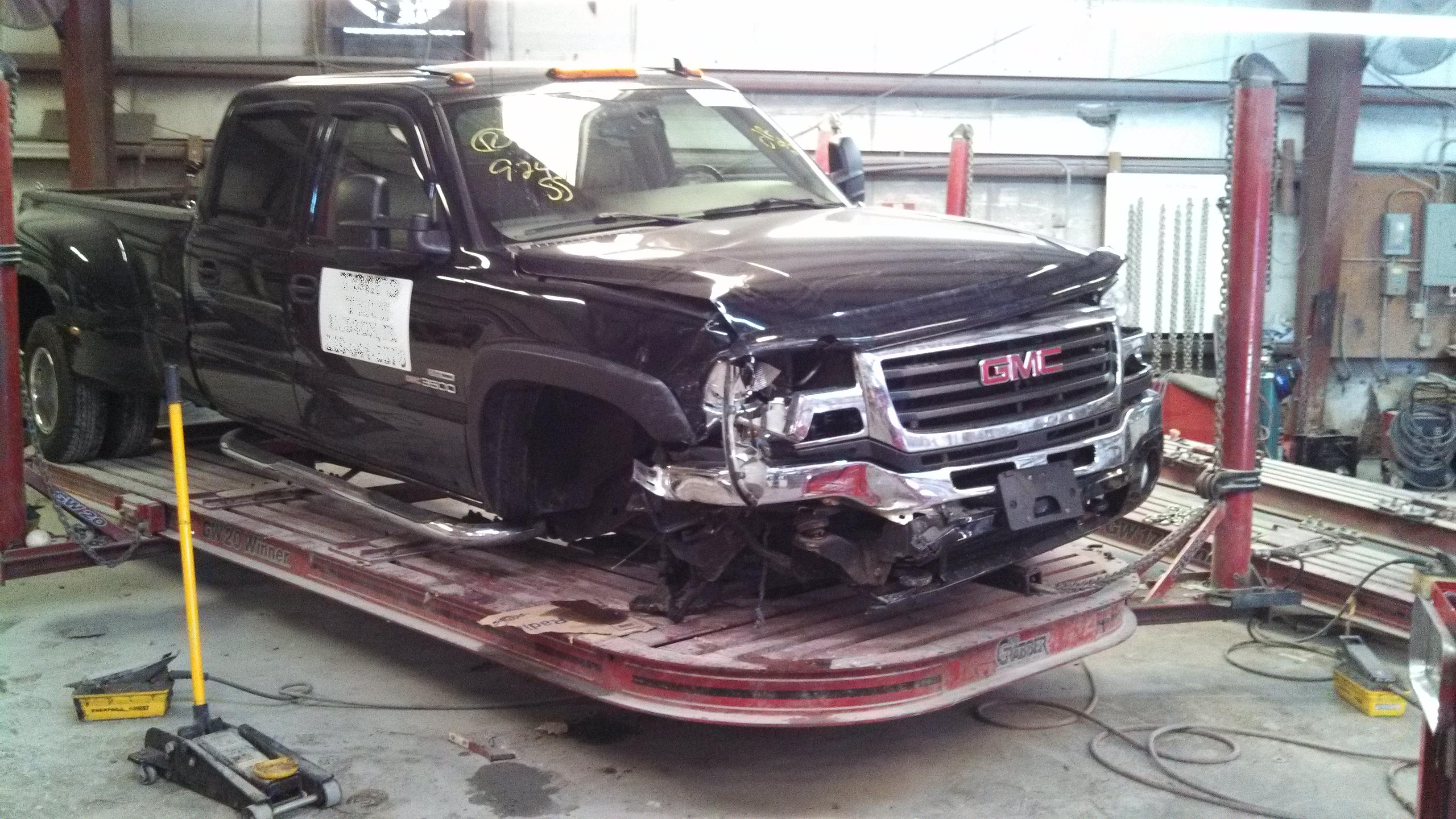 GMC hard front hit auto body collision repair work before